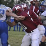 Football: Hard Hit for the Huskies [PHOTOS]