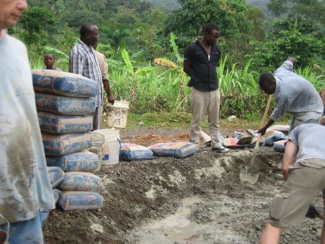 Mixing concrete for the church floor in Pilote