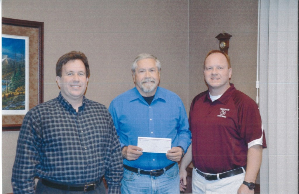Kevin Postier and JB Suddarth with Henderson State Bank presenting the Henderson Community Foundation President, Norm Yoder, with a check for $12,500 for the Henderson Community Foundation Scholarship Endowment.  This is the first instalment of a $25,000 donation by Henderson State Bank.